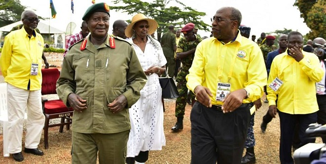 Museveni talks to PM Ruhakana Rugunda before one of the sessions at Kyankwanzi
