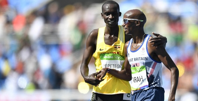 Britain's Mo Farah (R) shakes hands with Uganda's Joshua Kiprui Cheptegei after they competed in the Men's 5000m Round 1 during the athletics event at the Rio 2016 Olympic Games at the Olympic Stadium in Rio de Janeiro on August 17, 2016. / AFP PHOTO / Fabrice COFFRINI