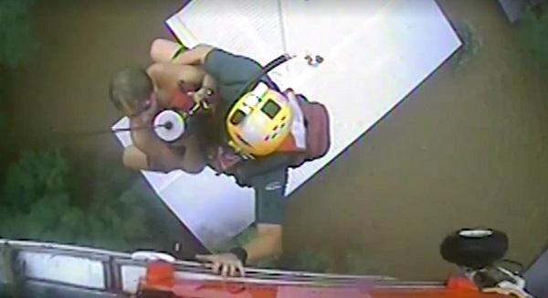 A US coastguard evacuates victims in Louisiana