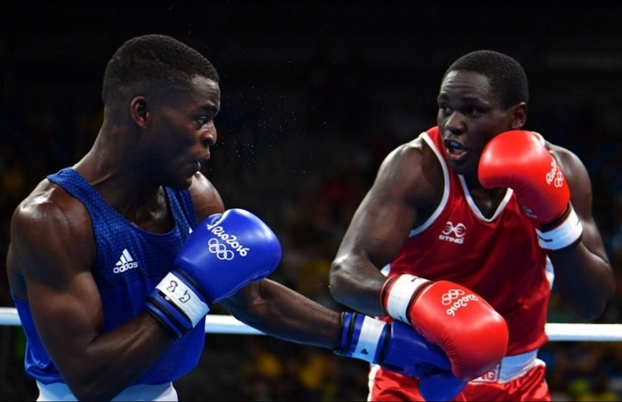 Great Britain's Joshua Buatsi (L) fights Uganda's Kennedy Katende during the Men's Light Heavy (81kg) boxing match at the Rio 2016 Olympic Games at the Riocentro - Pavilion 6 in Rio de Janeiro . AFP PHOTO