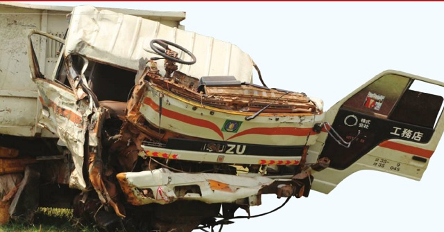 A mangled truck that was recently involved in an accident on Masaka road parked at Mpigi Police Headquarters. Independent/ Ronald Musoke