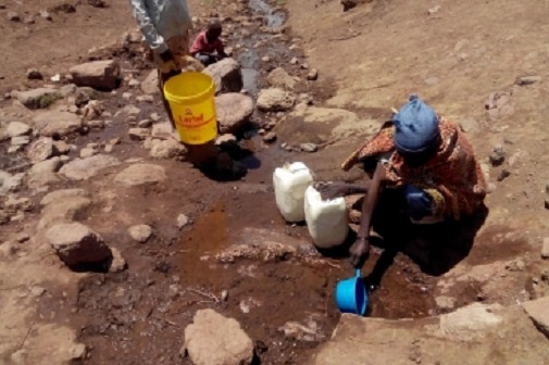 Collecting water from a river that has been reduced to a trickle in Mokhotlong district. PHOTO WFP